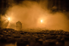 Ancient steam locomotive in night. Night train moving on railroad. orange fire background. Horror mystical scene. Train moving in fog. Ancient steam locomotive Royalty Free Stock Photo