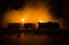 Ancient steam locomotive in night. Night train moving on railroad. orange fire background. Horror mystical scene. Train moving in fog. Ancient steam locomotive Stock Images