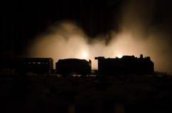 Ancient steam locomotive in night. Night train moving on railroad. orange fire background. Horror mystical scene. Train moving in fog. Ancient steam locomotive Royalty Free Stock Photos