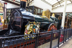 Ancient steam train in Windsor. Ancient steam train  with lion and unicorn on English heraldic coat of arms. Windsor. UK Royalty Free Stock Images