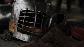 Ancient steel helmet and leather outfit of medieval knight at history museum. Stock footage stock video