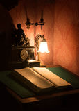 Ancient still life. Book under the lamp Stock Photo