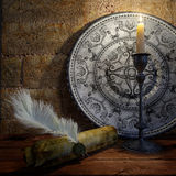 Ancient still life with candle and scroll concept Stock Photo