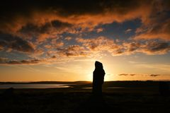 Ancient stone. A stone of the Ring of Brodgar in Orkney at sunset royalty free stock photos