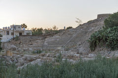 Ancient stone amphitheater ruins in Paphos Stock Image