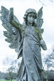 Ancient stone angel statue on a cemetery Royalty Free Stock Image