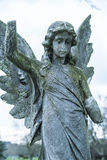 Ancient stone angel statue on a cemetery Royalty Free Stock Photos