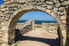 Stone arch in the ancient city of Hersonissos. Royalty Free Stock Photography
