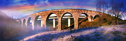 Ancient stone arch bridge. Built by Austria before World War II, is still used by passenger and freight trains in modern Ukraine, but has been built next to Royalty Free Stock Photo
