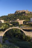 Ancient stone arch bridges with a background of Parador de Cardona, a 9th Century medieval hillside Castle, near Barcelona, Catalo Royalty Free Stock Photo
