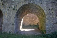 Ancient stone arch of a castle. Overlooking wall Stock Photo