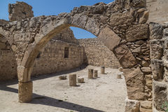 Ancient stone arch . Kolossi castle. Cyprus. Ancient stone arch on blue sky background. Archaeological excavations in Kolossi castle. Cyprus Stock Image