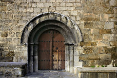 Ancient stone arch romanic architecture. Church in Spain Pyrenees Royalty Free Stock Images