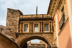 Ancient stone arch in Valencia. Between the Cathedral and the Basilica in the city center Royalty Free Stock Image