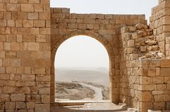 Ancient stone arch and wall with desert view durin Royalty Free Stock Images