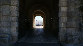 Ancient stone arched entrance to Cascais Citadel with courtyard at end, sequence. Stock footage stock video footage