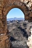 Stone archway at the Great Wall in Jinshanling in winter near Beijing in China royalty free stock image