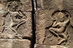 Ancient stone bas-relief of Banteay Kdei temple, Angkor Wat, Cambodia. Ancient bas-relief with apsara dance.
