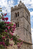 Ancient stone bell tower in Hum, croatian town, the smallest in the world. Stock Photo