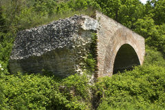 Ancient stone and brick face of the Chianche Bridge in Buonalbergo, Campania, Italy. An arch of the Chianche Bridge in Buonalbergo, Campania, Italy. The bridge Royalty Free Stock Images