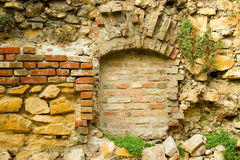 Ancient stone-brick wall with old window Royalty Free Stock Photo