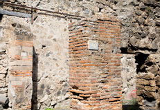 Ancient Stone and Brick Walls in Pompeii. Ancient walls of brick and stone in the lost city of Pompeii stock photo