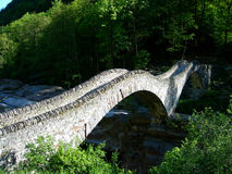 Ancient Stone Bridge. In Swiss Alps village royalty free stock photography