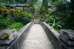 Ancient stone bridge in the Balinese jungle, Indonesia. Ancient stone bridge to the temple in the Balinese jungle, Indonesia Stock Images
