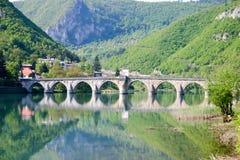 Ancient stone bridge on drina river. Famous historic bridge on drina river, visegrad city, bosnia and herzegovina royalty free stock image