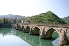 Ancient stone bridge on drina river. Famous historic bridge on drina river, visegrad city, bosnia and herzegovina stock image