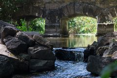 Ancient stone bridge over the river stock image