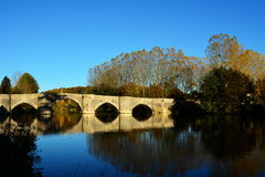 Ancient stone bridge over river stock images