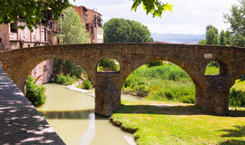 Ancient stone bridge over  river  in Vic Royalty Free Stock Photos