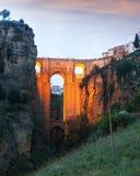 Ancient stone bridge in twilight. Ronda royalty free stock photo