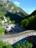 Ancient Stone Bridge and Villa. Ge in Switzerland, Swiss Alps royalty free stock photo