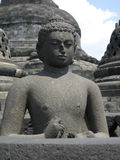 Ancient stone buddha at the Borobudur. Peaceful stone buddha almost at the highest point of the Borobudur, Indonesia Royalty Free Stock Photo