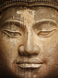 Ancient stone Buddha face close up Royalty Free Stock Images