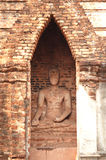 Ancient stone buddha in pagoda temple. Stock Photo