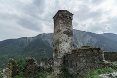 Ancient stone buildings in the mountains. Stone tower in the mountainous region of Georgia, Svaneti. The ruins of this fortification fascinate. The mountains in royalty free stock photo