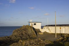 The ancient stone built boat house used by Royal Ulster Yacht Club race officials to monitor club races in Ballyholme Bay in Count. Y Down Northern Ireland. This Stock Photos