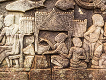 Ancient Stone Carving of Ancient Khmer LIfe Style Stock Image