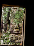 Ancient stone carving of smiling face at Bayon Temple Royalty Free Stock Image
