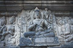 Ancient stone carvings in the Buddhist temple. Ancient stone carvings in the Borobudur Buddhist temple on Java, Indonesia Stock Photos