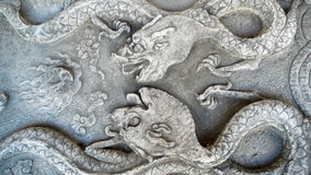 Ancient  stone carvings  of Dragon Stock Photos