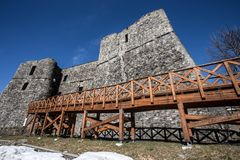 Ncient stone castle with a long wooden bridge. royalty free stock photo