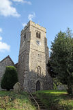 Ancient stone church tower and clock Royalty Free Stock Photography