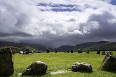 Ancient Stone Circle looking Upon Mountains. Stock Image