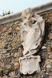 Ancient stone coat of arms. Civitavecchia, Italy Royalty Free Stock Photo