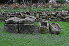 Ancient Stone Coffins. And Ornate Stone Wall Stock Image