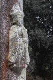 Ancient stone column of Saint James on tree background. Patron of pilgrims. Symbol of Camino de Santiago the way of Saint Jacob. stock photos
